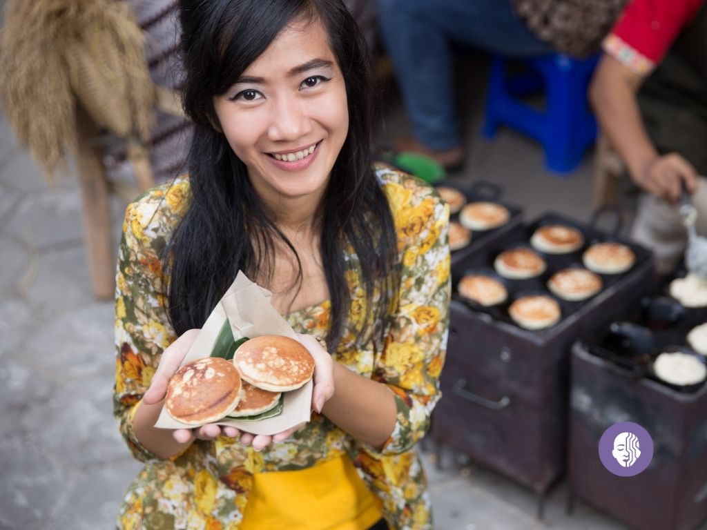 An Indonesian lady holding local street food